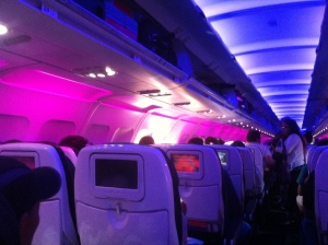 Transport to new and exciting vistas for some, hours of white-knuckled terror for others. You decide. Cabin interior, Virgin Airlines.