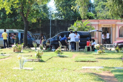 Family crypt and minivan become party rooms, Undas, Philippines