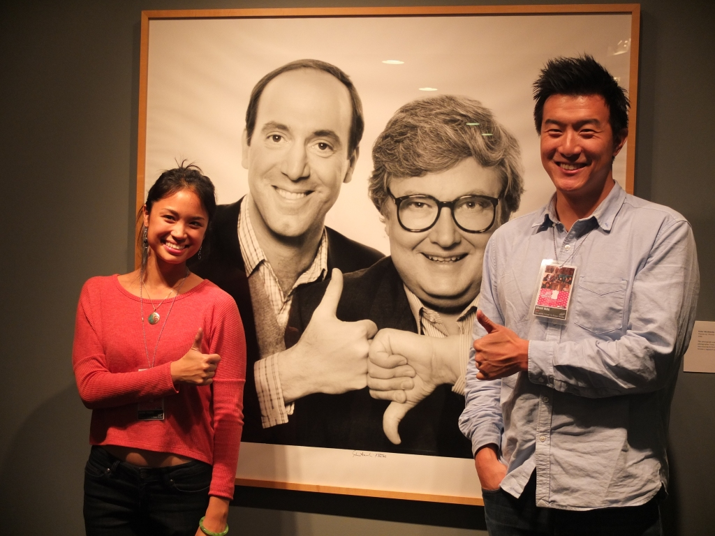 Director Nadine Truong and actor Brian Kang, with Gene Siskel and Roger Ebert portrait, Chicago Asian American Showcase, 2013.