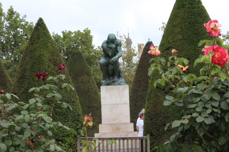 The Thinker, Eiffel Tower background, garden of Musee Rodin, Paris