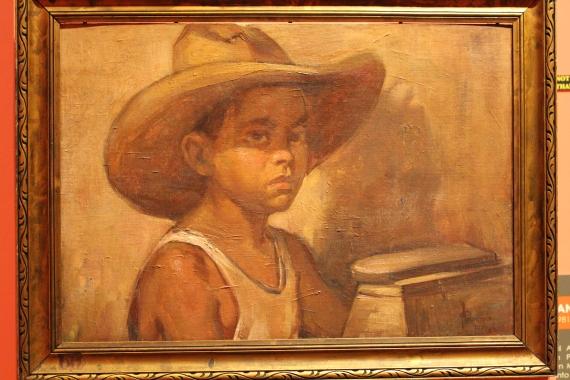"""Limpia Botas"" or Clean Boots by painter Pablo Amorsolo, University of Santo Tomas Museum, Manila, Philippines"