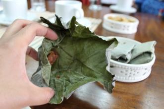Unfold the aromatic, dried pili nut leaf wrapping