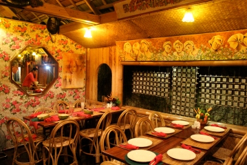 Wood carvings, paintings and frescos, KaLui Restaurant, Puerto Princesa, Palawan, Philippines