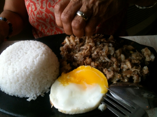 Sisig (spicy pork hash) on a sizzling plate, Razon's of Pampanga